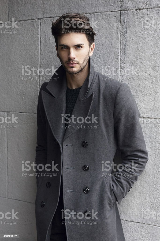 Young handsome man in a coat stock photo