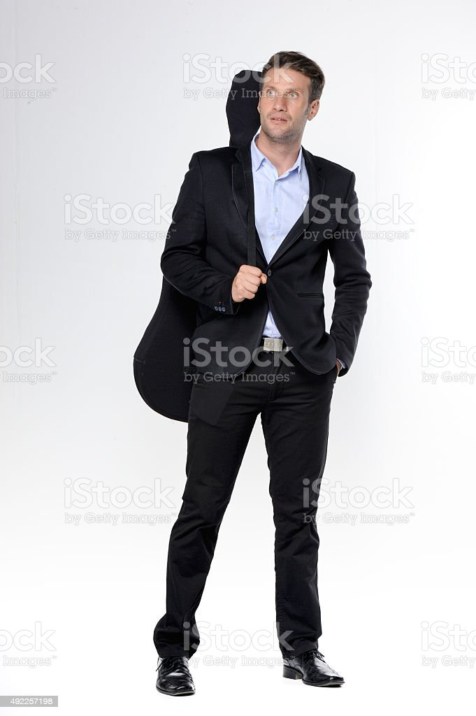 Young handsome man in a dark business stock photo