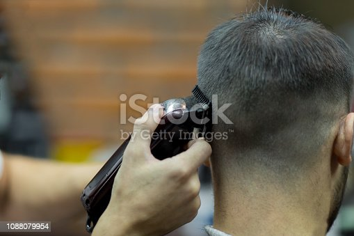 932956896istockphoto Young handsome man in barbershop 1088079954