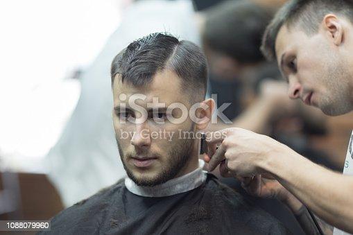 932956896istockphoto Young handsome man in barbershop 1088079960