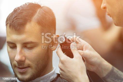 932956896istockphoto Young handsome man in barbershop 1088079964