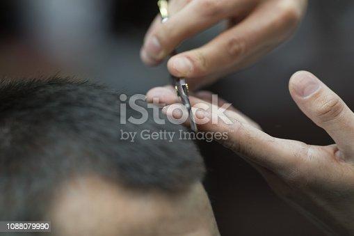 932956896istockphoto Young handsome man in barbershop 1088079990