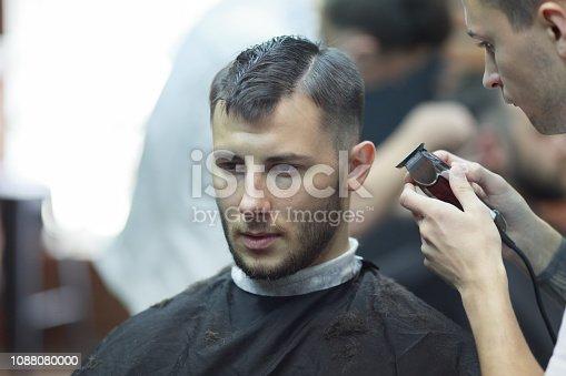 932956896istockphoto Young handsome man in barbershop 1088080000