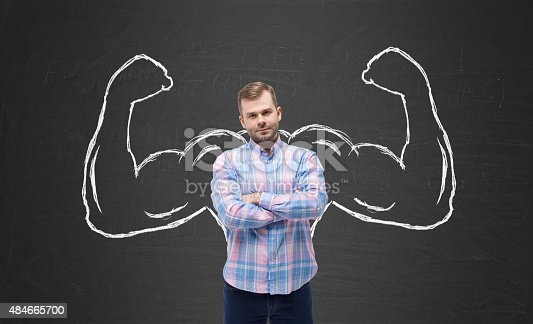 istock Young handsome man in casual shirt with drawn powerful hands 484665700