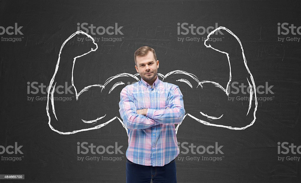 Young handsome man in casual shirt with drawn powerful hands stock photo