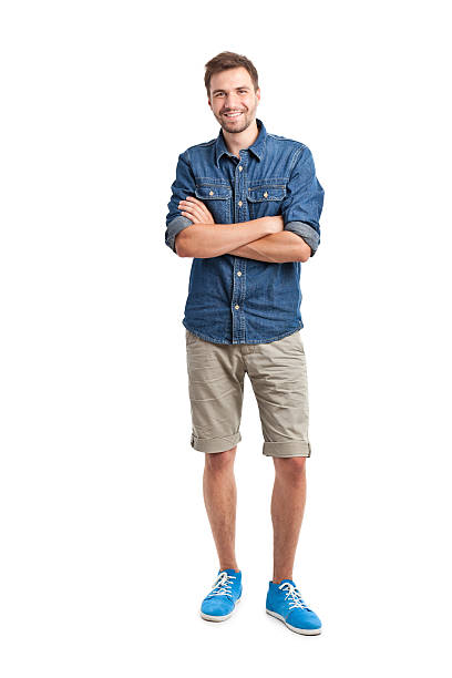 young handsome man in jeans shirt young handsome man in jeans shirt isolated on white shorts stock pictures, royalty-free photos & images