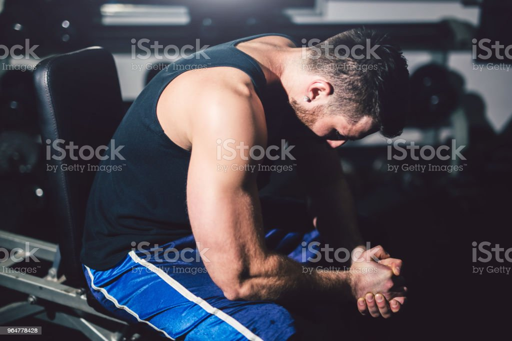 Young handsome man is prepared for exercise in the gym. royalty-free stock photo