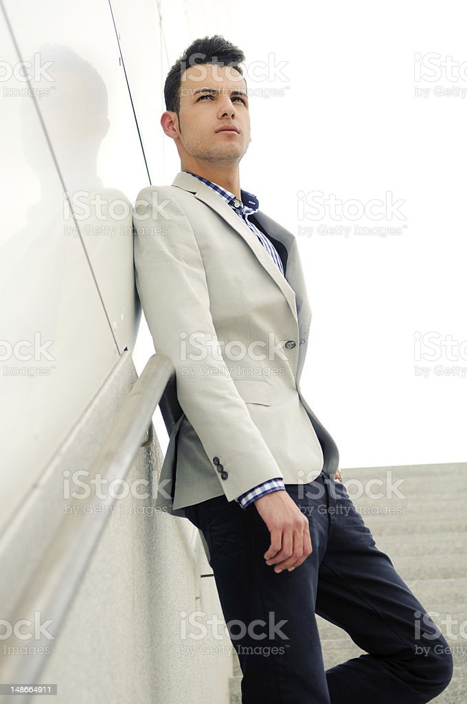 Young handsome man, model of fashion, wearing jacket and shirt royalty-free stock photo