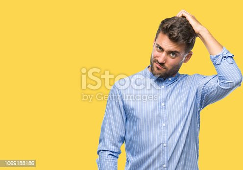 Young handsome man over isolated background confuse and wonder about question. Uncertain with doubt, thinking with hand on head. Pensive concept.