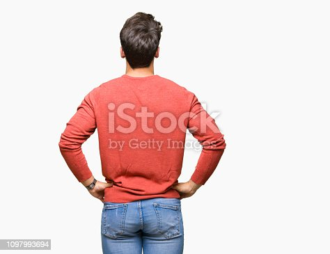 istock Young handsome man over isolated background standing backwards looking away with arms on body 1097993694