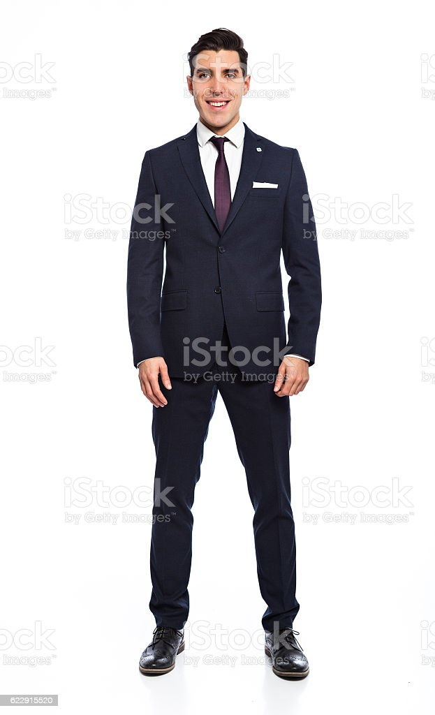Young handsome man posing in studio wearing fashionable suit – Foto