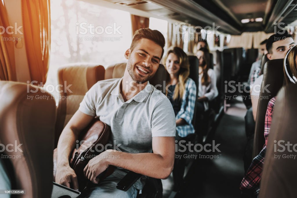 Young Handsome Man Relaxing in Seat of Tour Bus stock photo