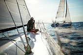 Young handsome man relaxing on his sport sailboat