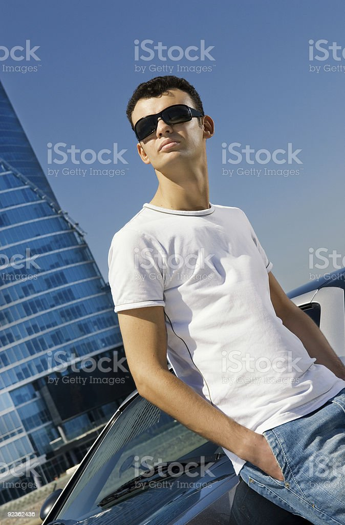 Young handsome man relaxing outdoors royalty-free stock photo