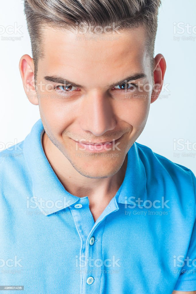 young handsome man smiling at the camera. stock photo