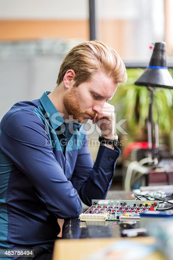 483784268 istock photo Young handsome man thinking while soldering a circuit board 483786494
