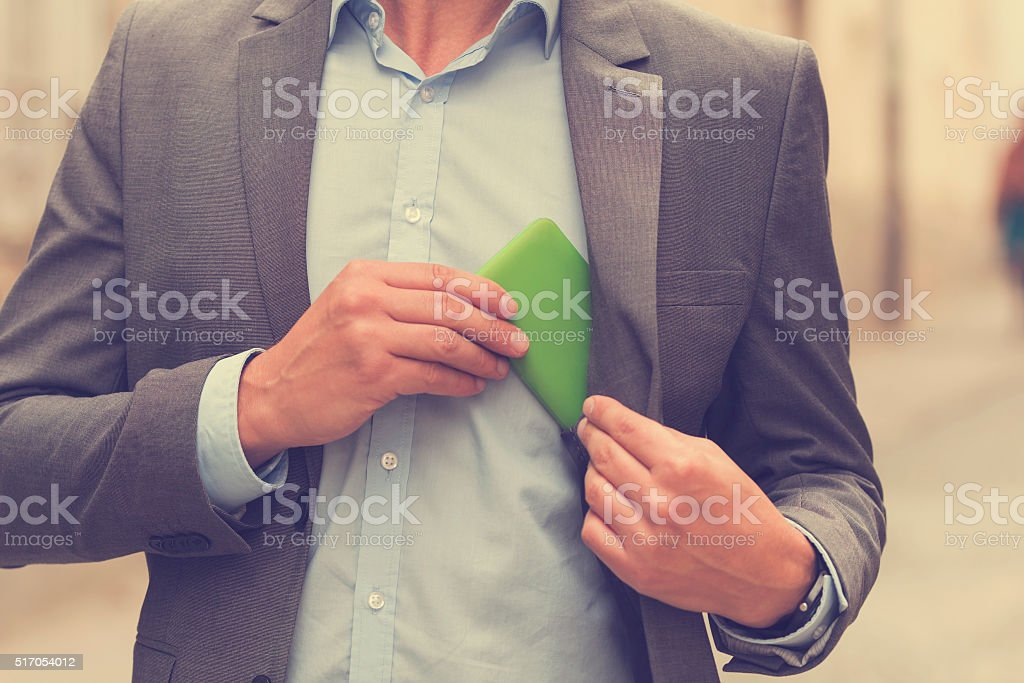 Young handsome man using smartphone. stock photo