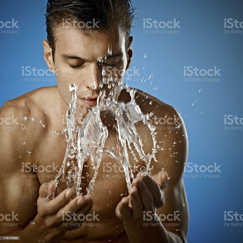 Young Handsome Man Washing Face royalty-free stock photo