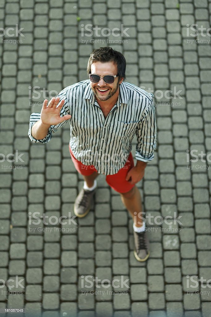 Young handsome man waving hi royalty-free stock photo