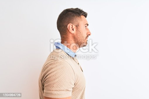 1045886560 istock photo Young handsome man wearing elegant t-shirt over isolated background looking to side, relax profile pose with natural face with confident smile. 1204994726