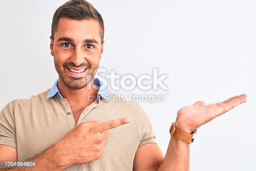 1045886560 istock photo Young handsome man wearing elegant t-shirt over isolated background very happy pointing with hand and finger 1204994804