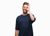 istock Young handsome man wearing winter sweater over isolated background doing ok gesture with hand smiling, eye looking through fingers with happy face. 1042828162