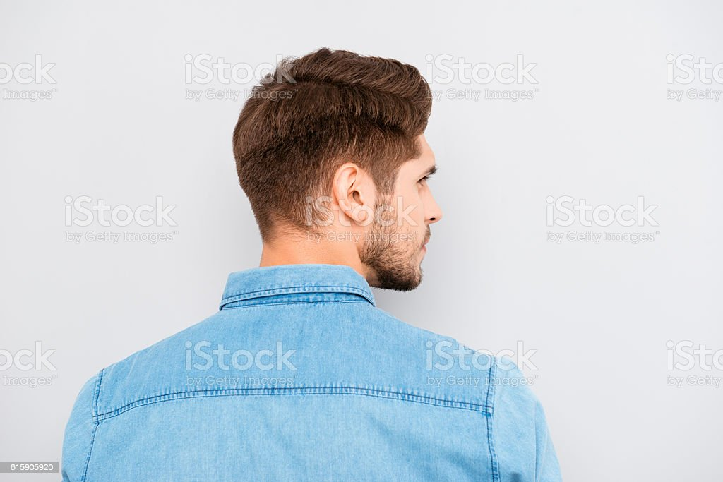 young handsome man with bristle in blue shirt stock photo