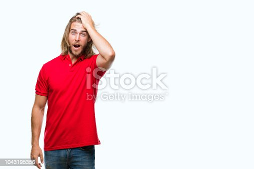 1046559700istockphoto Young handsome man with long hair over isolated background surprised with hand on head for mistake, remember error. Forgot, bad memory concept. 1043195356