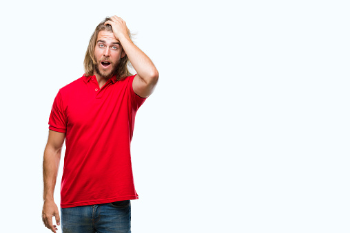 1046559700 istock photo Young handsome man with long hair over isolated background surprised with hand on head for mistake, remember error. Forgot, bad memory concept. 1043195356