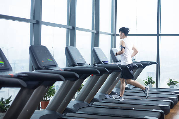 young handsome man works out in modern gym stock photo