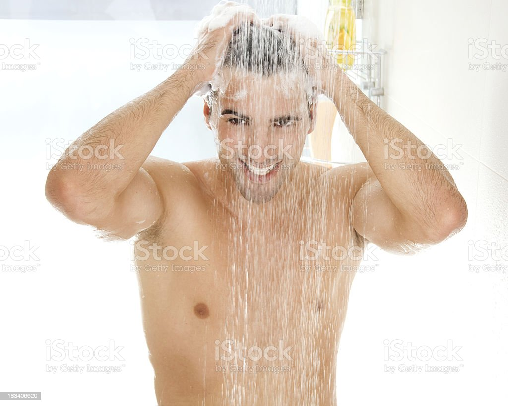 Young handsome men taking a shower. stock photo