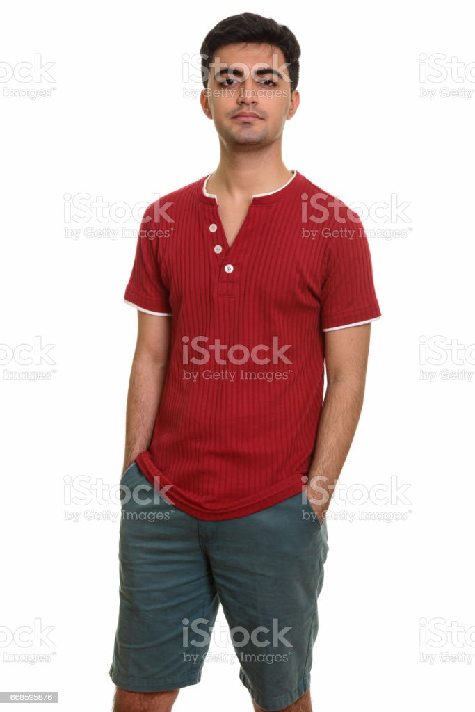 Young handsome Persian man standing stock photo