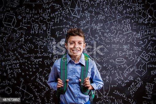 istock Young handsome school boy 487673852