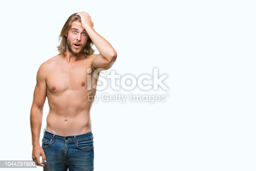 1046559700istockphoto Young handsome shirtless man with long hair showing sexy body over isolated background surprised with hand on head for mistake, remember error. Forgot, bad memory concept. 1044291650