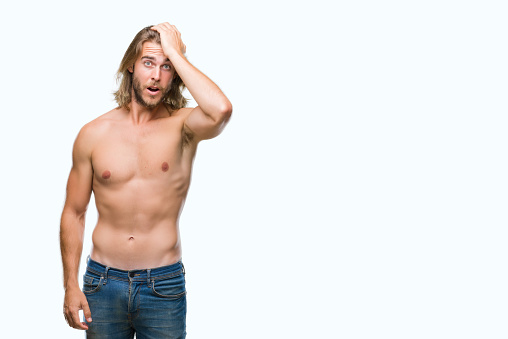 1046559700 istock photo Young handsome shirtless man with long hair showing sexy body over isolated background surprised with hand on head for mistake, remember error. Forgot, bad memory concept. 1044291650