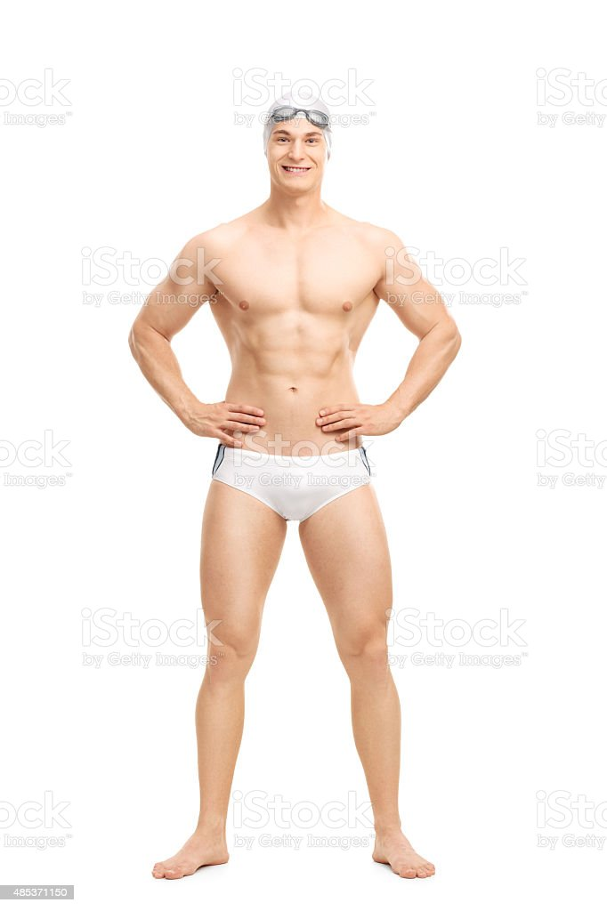 Young handsome swimmer posing in white swim trunks stock photo