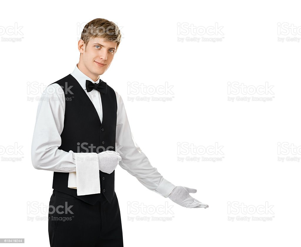 Young handsome waiter gesturing welcome stock photo