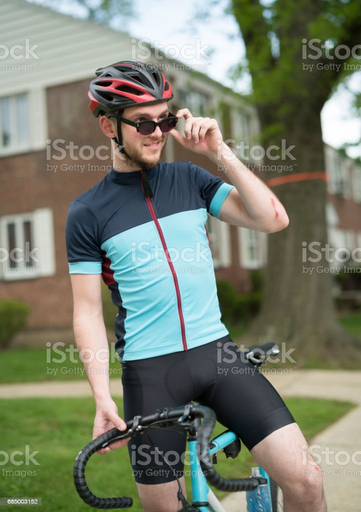 Young handsome well trained man posing with the sport bicycle stock photo