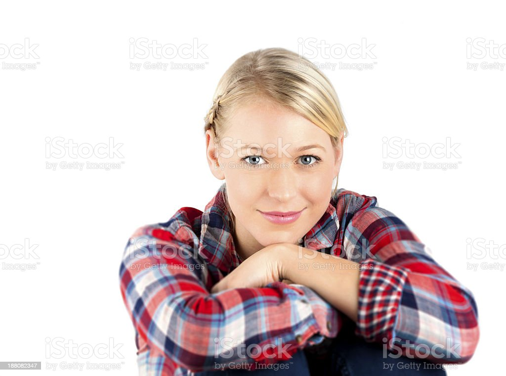 Young handsome woman casually posing with arms crossed and sitting royalty-free stock photo