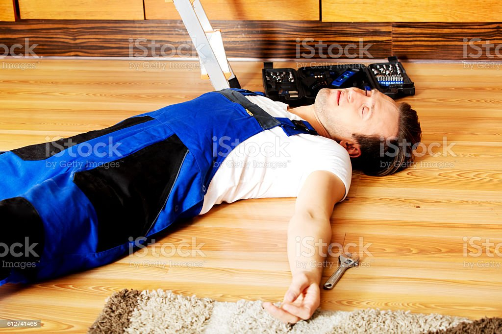 Young handyman fell from a ladder stock photo