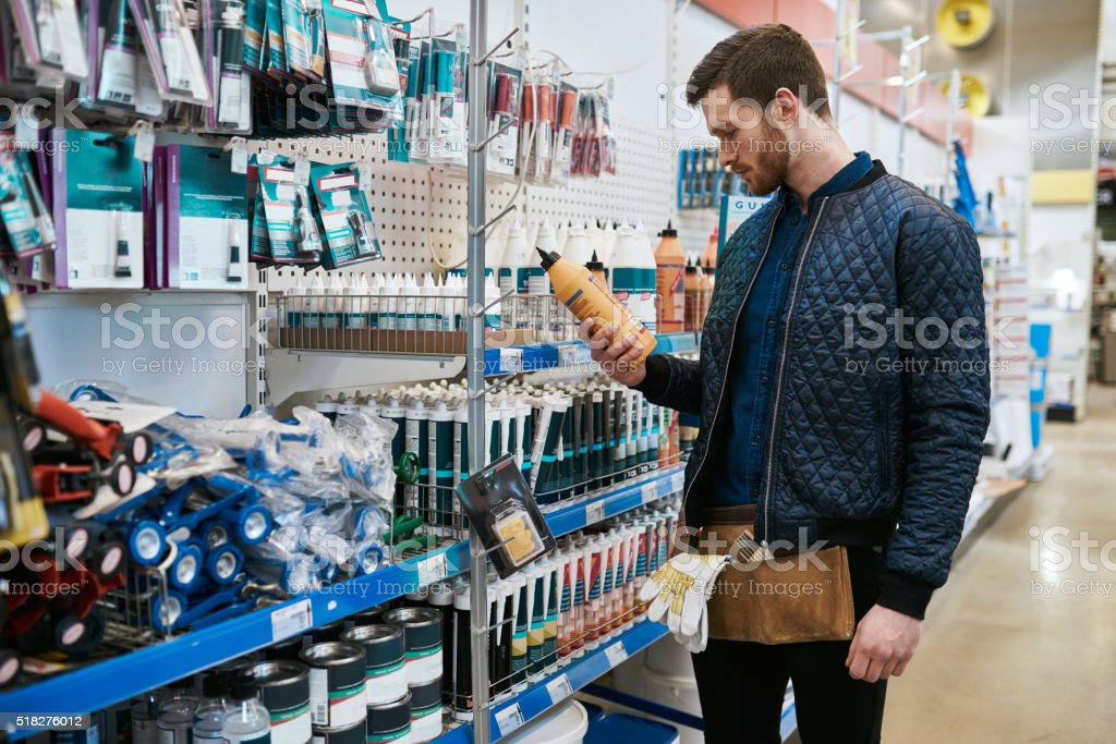 Young handyman or DIY homeowner in a store stock photo