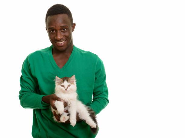 Young happy african man smiling and holding cute cat picture id668690738?b=1&k=6&m=668690738&s=612x612&w=0&h=ckti9jt0ticlpbmufq82izmuvxswnimw4qxla0oi12k=