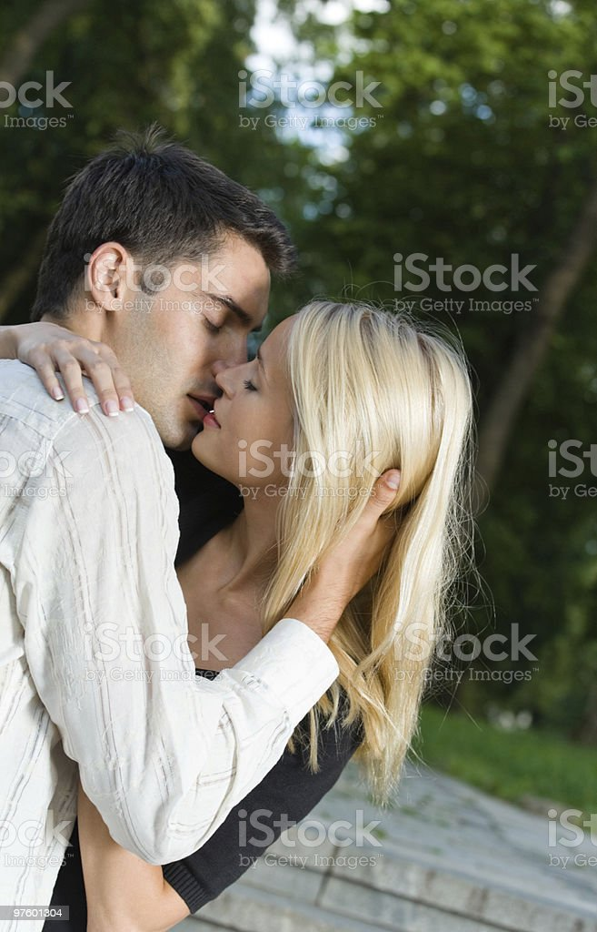 Young happy amorous couple kissing, outdoors royalty-free stock photo