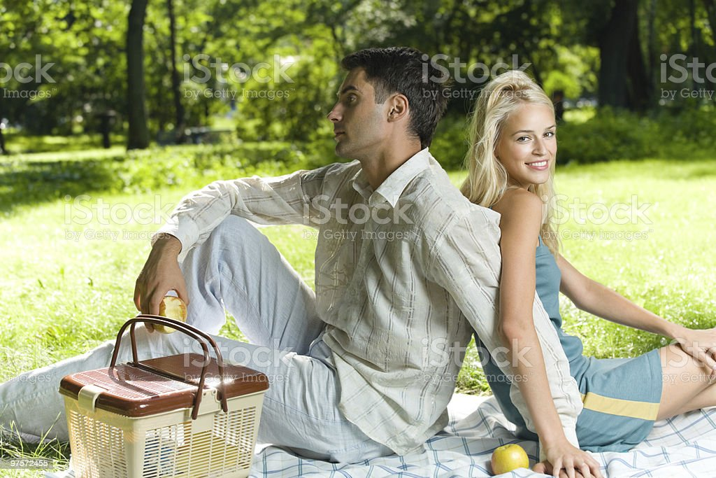 Young happy amorous couple together at picnic royalty-free stock photo