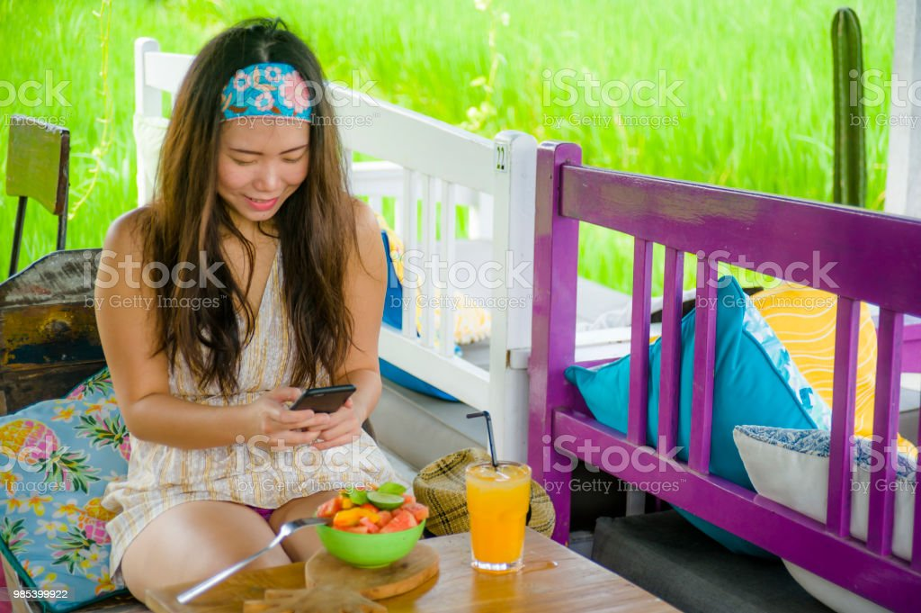 Young Happy And Pretty Digital Nomad Asian Korean Woman