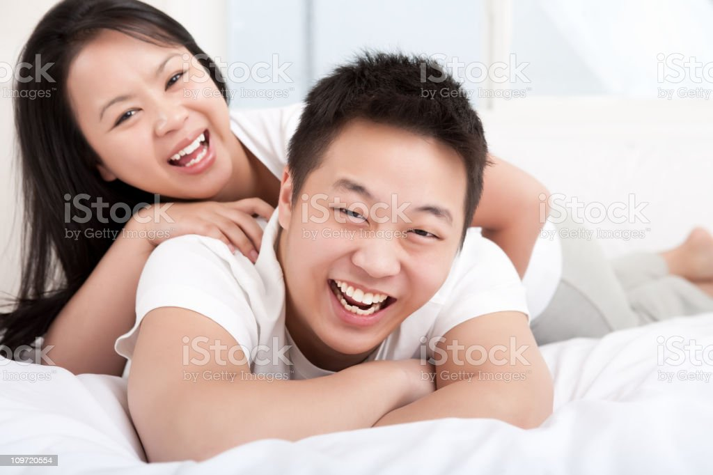 Young happy asian couple bedroom portrait royalty-free stock photo