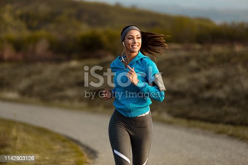 1142900322 istock photo Young happy athletic woman jogging in nature. 1142903126