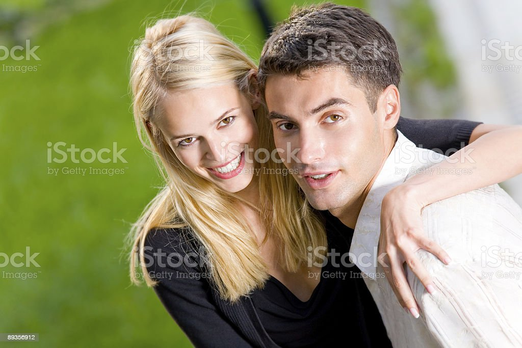 Young happy attractive embracing couple, outdoors royalty free stockfoto