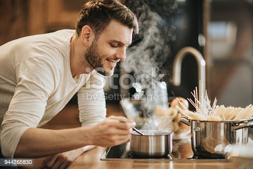 Happy man enjoying in the smell of his delicious meal.