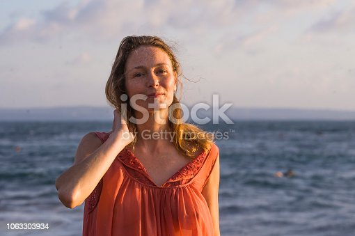istock young happy beautiful and glamorous blond woman posing as at the beach wearing stylish dress smiling cheerful feeling fresh and free at the sea in holidays travel and beauty fashion concept 1063303934